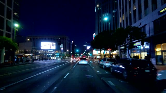 los angeles ii synced series front view driving process plate - street light stock videos & royalty-free footage