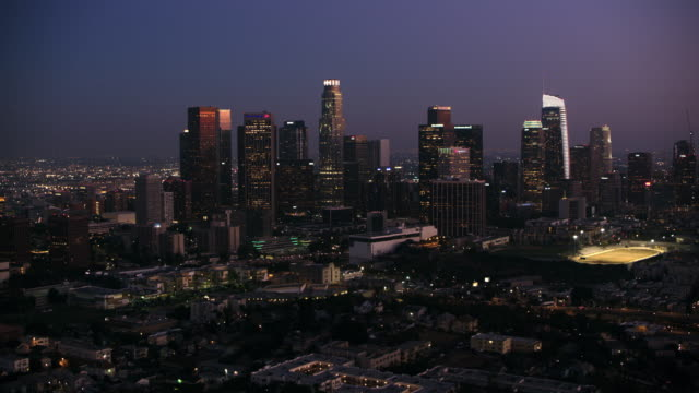 aerial los angeles in the evening - city of los angeles stock videos & royalty-free footage