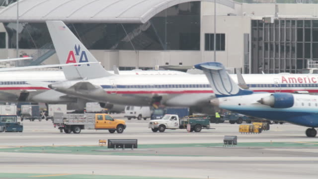 los angeles international airport / runway activity during president barack obama's visit to los angeles / security presence with airport police... - storage tank stock videos and b-roll footage