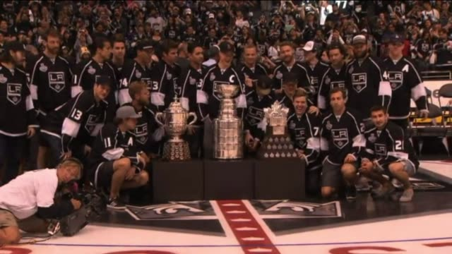 Los Angeles Kings Players Pose with Stanley Cup at Staples Center