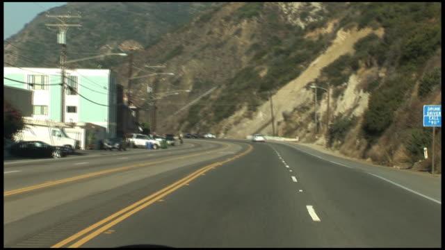 "stockvideo's en b-roll-footage met (hd1080) los angeles:  malibu, driving winding ""pacific coast highway"" pch - malibu"