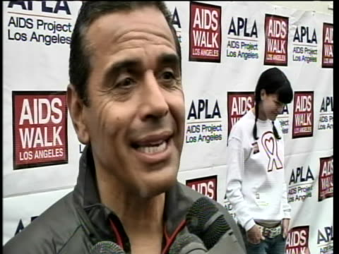 """los angeles mayor, antonio villaraigosa, comments on aids walk, which help to support those living with hiv and aids. he says, """"thirty thousand... - retrovirus video stock e b–roll"""