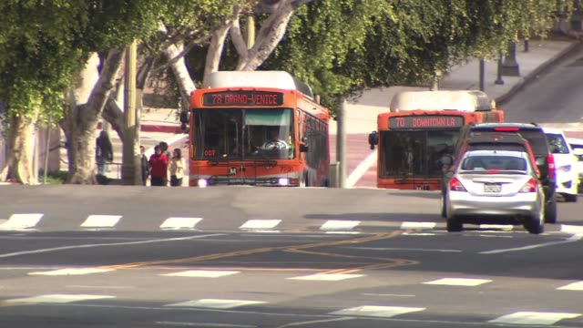 los angeles metro buses in downtown traffic - public transport stock videos & royalty-free footage