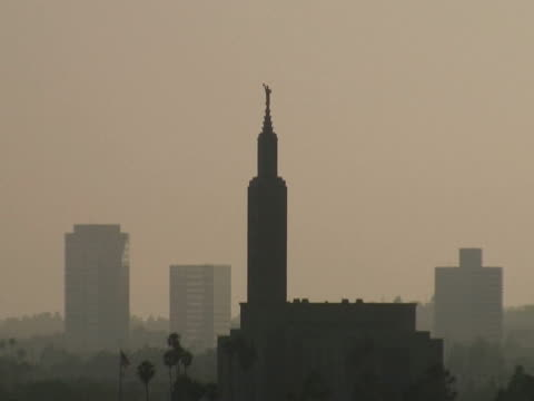 los angeles: mormon lds temple. hazy sky, pull out - mormon temple stock videos and b-roll footage
