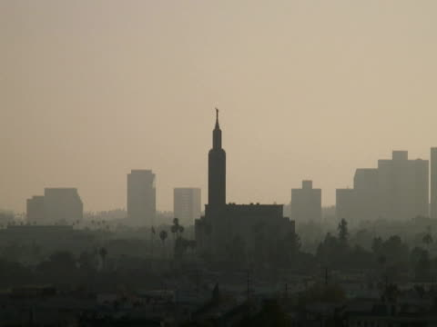 los angeles: mormon lds temple. hazy sky, push in - mormon temple stock videos and b-roll footage