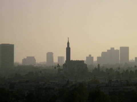 los angeles: mormon temple. hazy sky, push from wider - mormon temple stock videos and b-roll footage