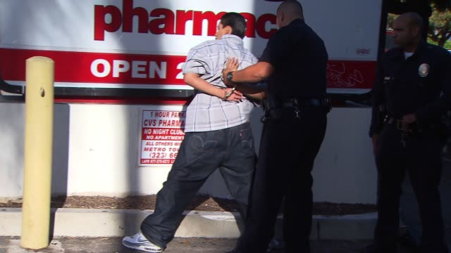 los angeles police officers arrest two latino males at a traffic stop on june 21, 2013 in los angeles, california - los angeles police department stock videos & royalty-free footage