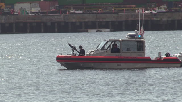 los angeles port police and u.s. coast guard patrol the waters in port of los angeles where usns mercy is docked, april 4, 2020 in san pedro,... - port of los angeles stock videos & royalty-free footage