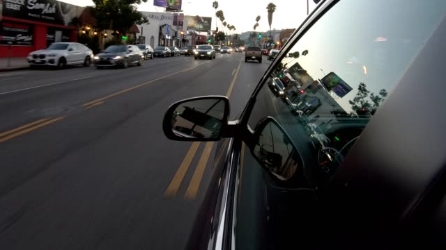 los angeles side window view reflection dusk dutch angle iv - beverly hills california stock videos & royalty-free footage