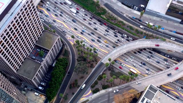 los angeles skyline aerial video sunset - motorway stock videos & royalty-free footage
