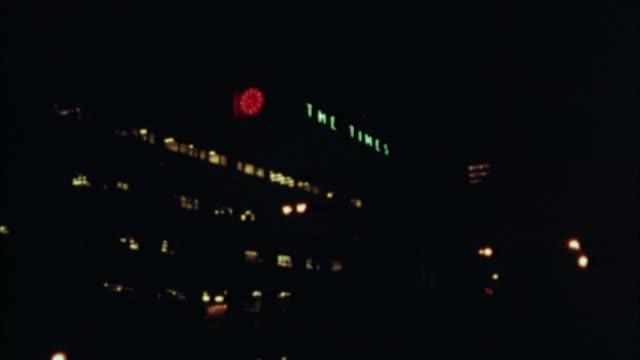 ws, los angeles times building illuminated at night, 1970's, los angeles, california, usa - anno 1973 video stock e b–roll