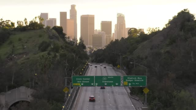 los angeles traffic 110 freeway in major cities in the u.s. adjust to restrictive coronavirus measures on march 15, 2020 in los angeles, california,... - major road video stock e b–roll