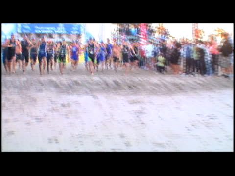 los angeles triathlon swim start into the ocean from the beach los angeles triathlon swim start beach to pacific on january 21 2012 in los angeles ca - salmini stock videos and b-roll footage