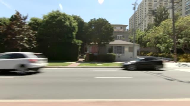 stockvideo's en b-roll-footage met los angeles vii gesynchroniseerde serie linker weergave rijproces plaat - boulevard