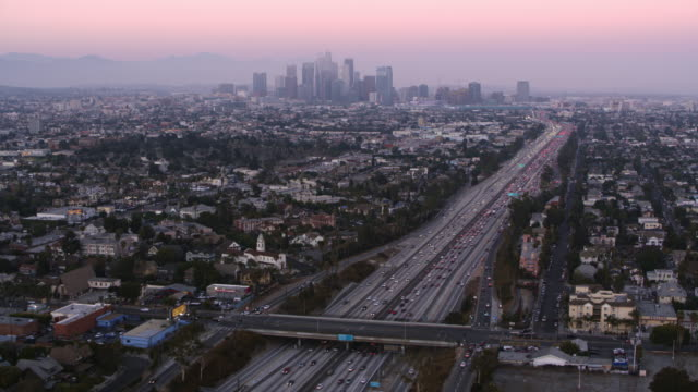 aerial los angeles with downton in the background at sunset - traffic stock videos & royalty-free footage