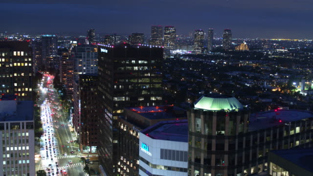 los angles lit up at night from westwood - drone shot - westwood neighborhood los angeles stock videos & royalty-free footage