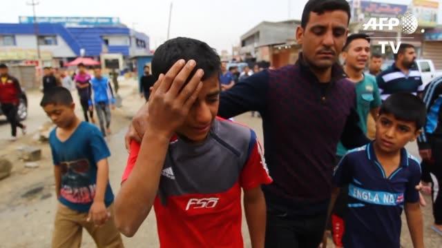 los iraquies lloraban este sabado a las 32 victimas del atentado registrado durante un partido de futbol en al asriya al sur de bagdad - irak stock videos and b-roll footage