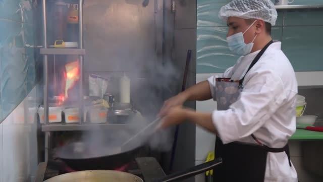 los restaurantes en perú, un país cuya gastronomía goza de fama internacional, volvieron a recibir clientes este lunes después de cuatro meses, pero... - restaurante stock videos & royalty-free footage