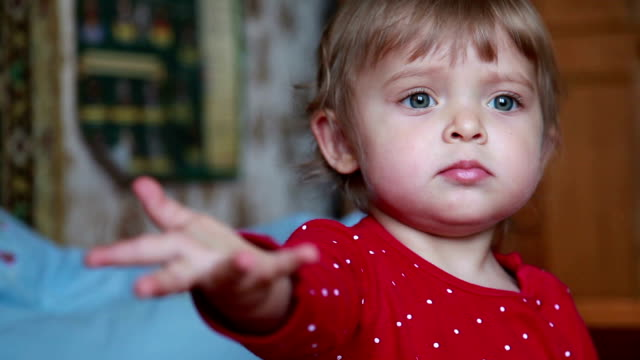 сlose-up of a baby reaching out her hand to the camera - reaching stock videos & royalty-free footage