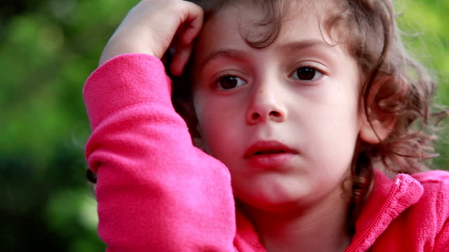 сlose-up of a little girl playing with her hair - pointing stock videos & royalty-free footage