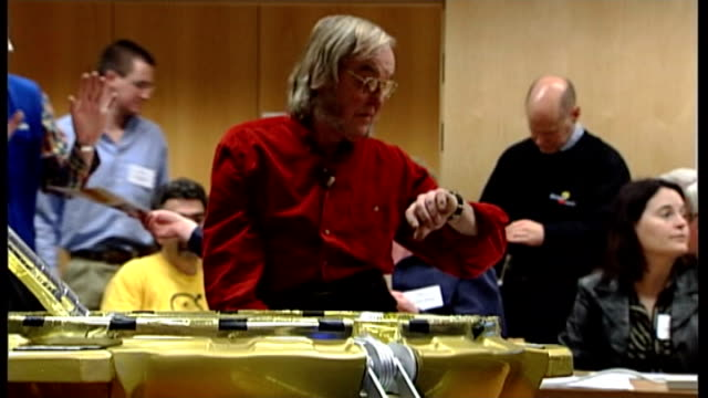'lost' beagle 2 space probe found on mars tx professor colin pillinger and others sitting in room awaiting information about beagle 2 mission/... - beagle stock videos & royalty-free footage