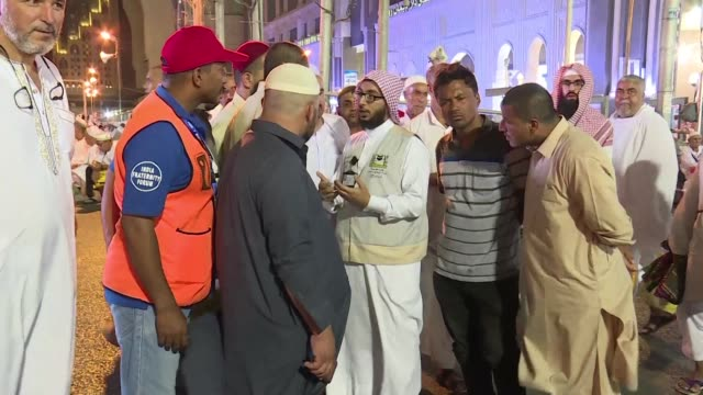 lost in translation not in mecca thanks to a dedicated squad of interpreters gearing up to help two million muslims speaking dozens of languages at... - hajj stock videos & royalty-free footage