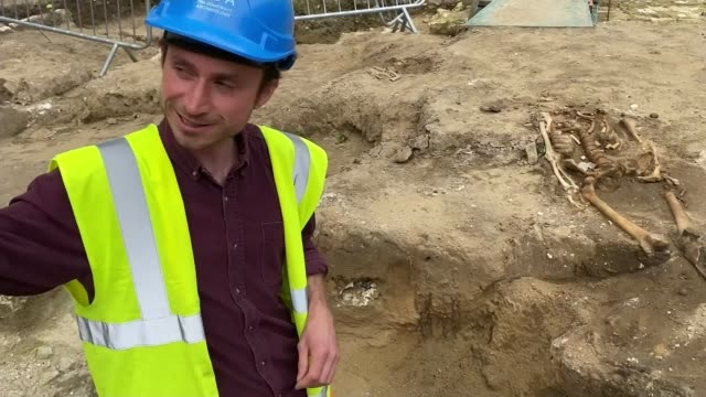 lost medieval sacristy uncovered at westminster abbey; england: london: westminster: ext joe brooks chatting with reporter as touring dig site sot... - digging stock videos & royalty-free footage