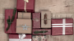 A lot of christmas presents on wooden background