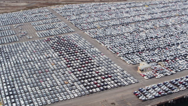 lot of new cars on dock in port - aerial shot - high up stock videos & royalty-free footage