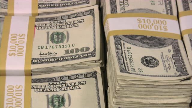 lots of cash money. american dollars. us paper currency. - bundle stock videos & royalty-free footage