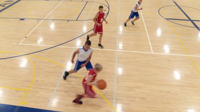 lots of passing on coed middle school basketball team - drive ball sports stock videos & royalty-free footage