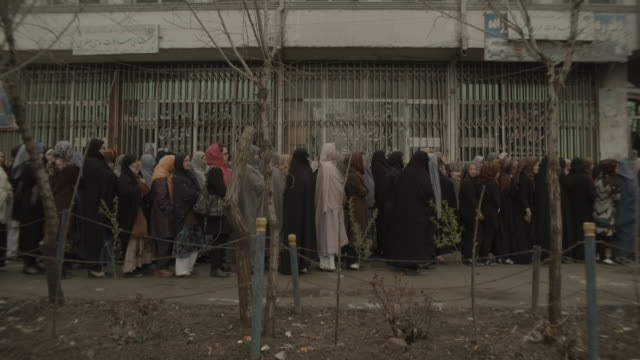 lots of women waiting in line - kabul video stock e b–roll