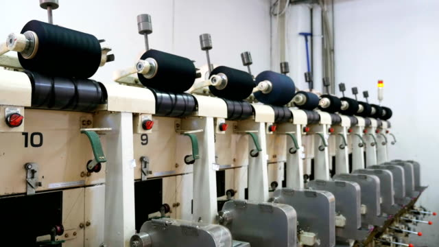 lots of yarn spools  in textile factory - ball of wool stock videos & royalty-free footage