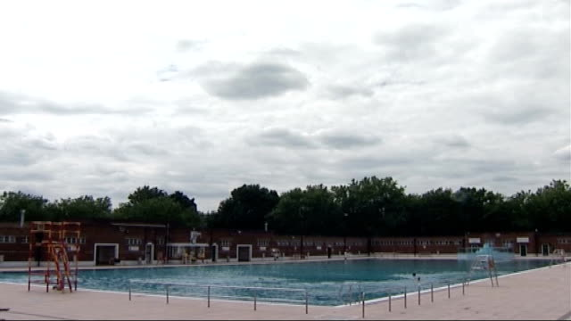 lottery funds secure the restoration of two lidos woman sunbathing next to pool cloudy sky tilt down to general view of recently restored parliament... - parliament hill stock videos and b-roll footage