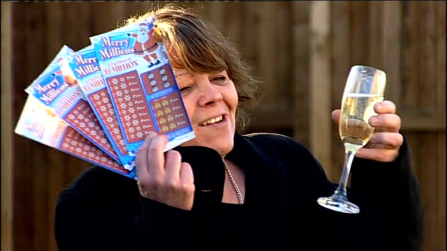 lottery scratchcard winner maria murray; england: ext maria murray spraying bottle of champagne and holding lottery tickets maria murray interview... - scratch card stock videos & royalty-free footage