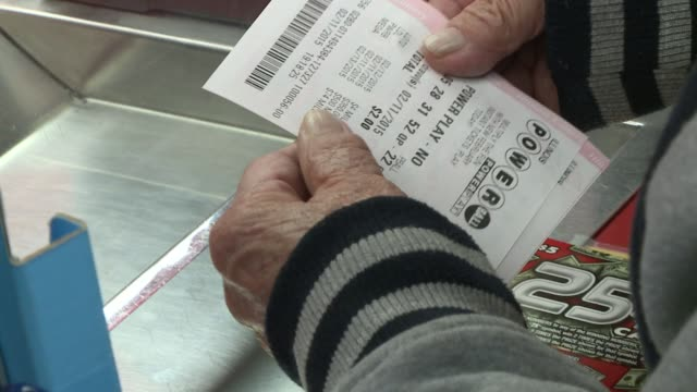 lottery tickets for sale at a convenience store when the jackpot was for $564 million on feb. 12, 2015. - lottery stock videos & royalty-free footage