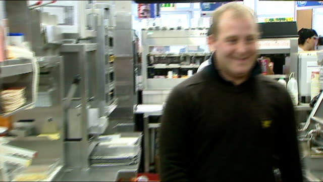 lottery winner returns to job at mcdonald's wales cardiff int luke pittard at work in kitchen of mcdonald's fastfood chain restaurant - mcdonald's stock videos and b-roll footage