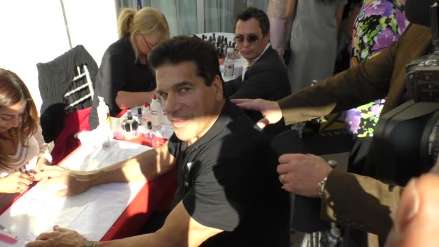 Lou Ferrigno gets his fingernails painted at Roger Neal Style Hollywood Beauty Couture Academy Award Suite at Luxe Hotel in Beverly Hills on February...
