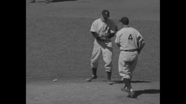 Lou Gehrig New York Yankees selects bat from rack in front of dugout / bat moving so close to camera it's difficult to distinguish Yankee players at...