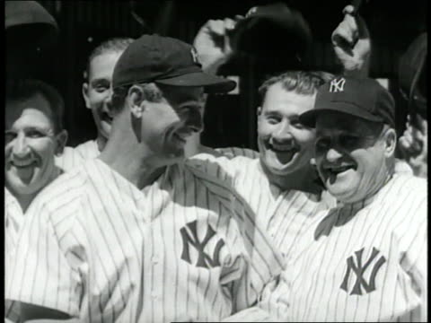Lou Gehrig smiles and stands with New York Yankees Manager Joe McCarthy then goes on to bat and run the bases in Yankee Stadium