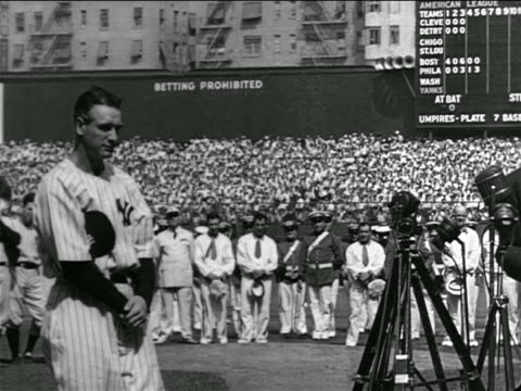 lou gehrig standing solemnly in center of crowded stadium / farewell speech - lou gehrig stock videos & royalty-free footage