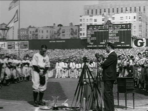 lou gehrig standing with head down in crowded stadium / farewell speech - lou gehrig stock videos & royalty-free footage