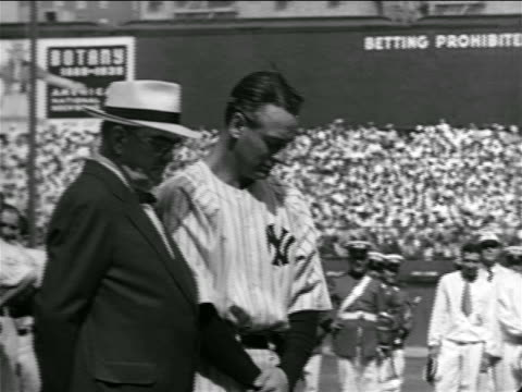Lou Gehrig with head down next to Ed Barrow / farewell