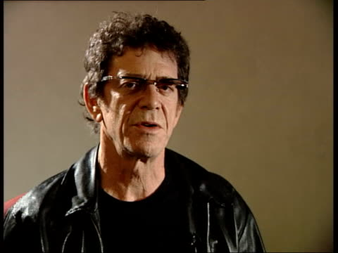 lou reed interviewed about 'three chords is good enough for me' lyric sot - sure, how many do you need / there's something about that chord formation... - ルー リード点の映像素材/bロール