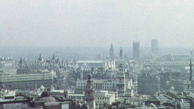 1962 montage loud, high-pitched alarm system warning citizens of london's metropolitan area / london, england, united kingdom - 1962年点の映像素材/bロール