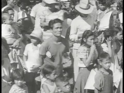 loudspeaker w/ japanese flag, brief sot japanese female speaking. vs filipinos people handing japanese propaganda flyers, leaflets to other... - philippinischer abstammung stock-videos und b-roll-filmmaterial