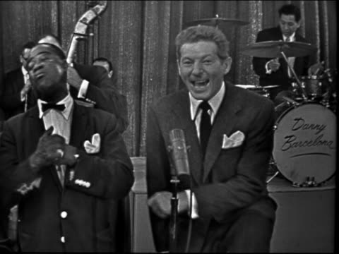 vídeos de stock e filmes b-roll de louis armstrong danny kaye singing together on stage in front of band / television show - 1958