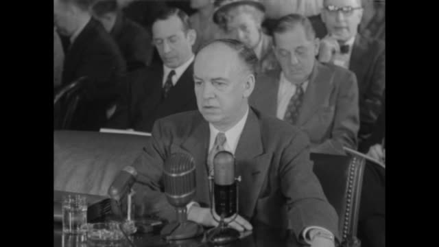 MS Louis Budenz former Communist and current antiCommunist sits before microphones on table during his testimony before the Senate Subcommittee on...
