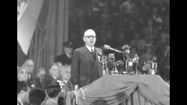 Louis St Laurent / VS delegates in convention hall / MS James Garfield Gardiner at podium with many radio mikes on it says 'This decision be made...