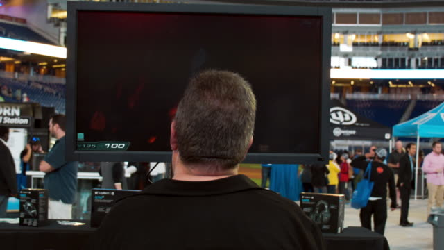 louis valdes checks out the items on display at the logitech booth as he plays a doom 3 videogame during the tigerdirect tech bash at the miami... - hopelessness stock videos & royalty-free footage